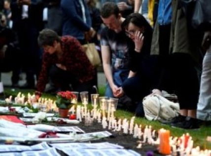 People light candles during a vigil in memory of the victims of the gay nightclub mass shooting in Orlando, at St Anne's church in the Soho district of London, June 13, 2016. REUTERS/Dylan Martinez