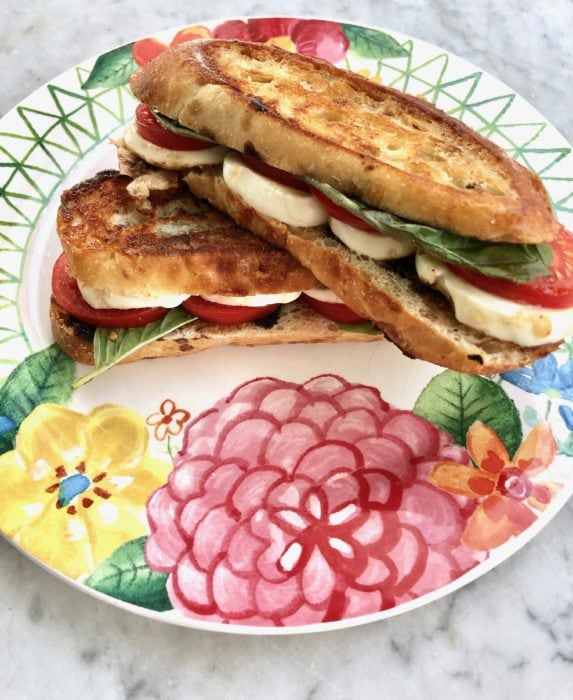 caprese panini on colorful plate