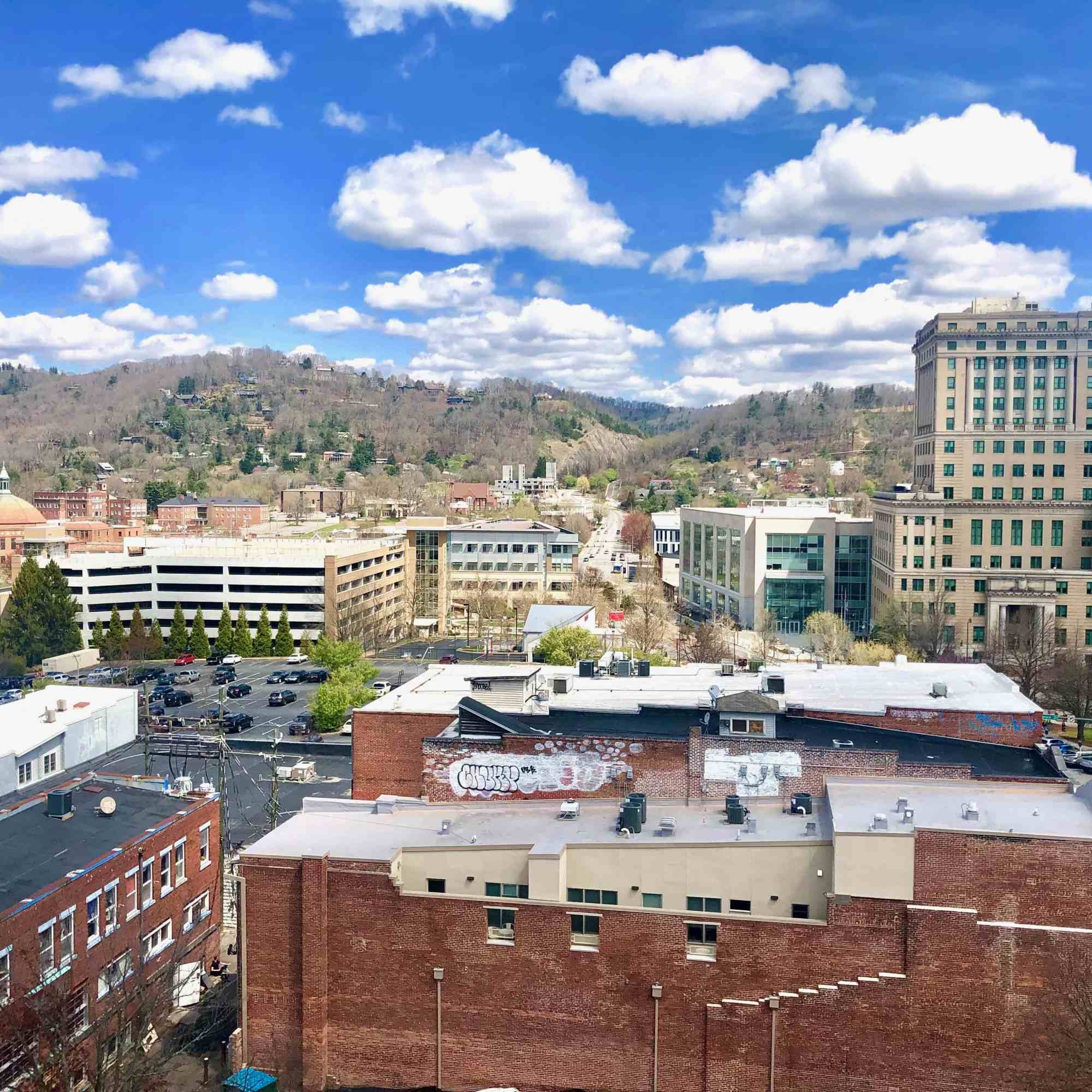12 rooftop views in Asheville with view of buildings and mountains in Asheville NC