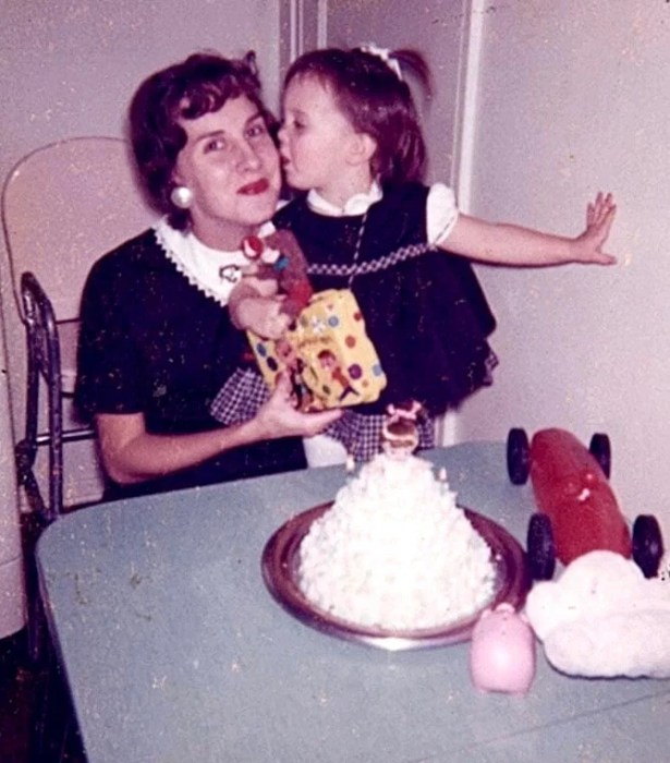 Debi giving her Momma a kiss when she was 2 years old