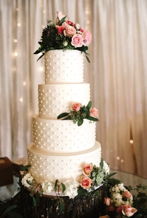 4 tier wedding cake with polka dots