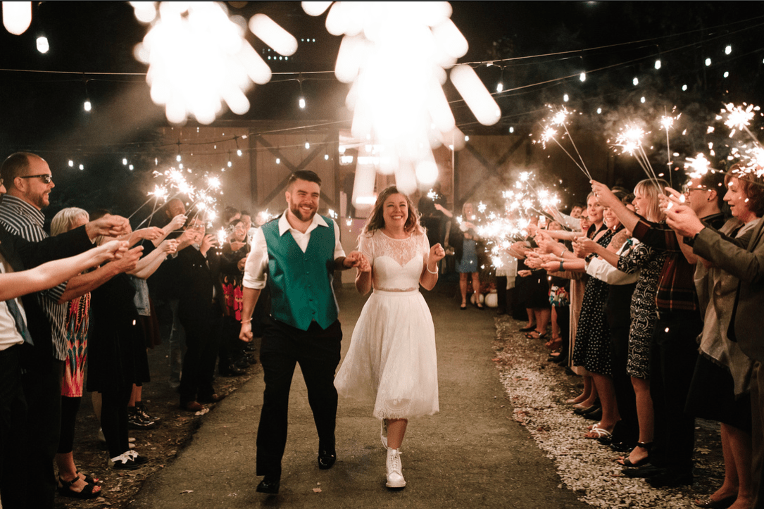 bride and groom running through sparkler send off at wedding