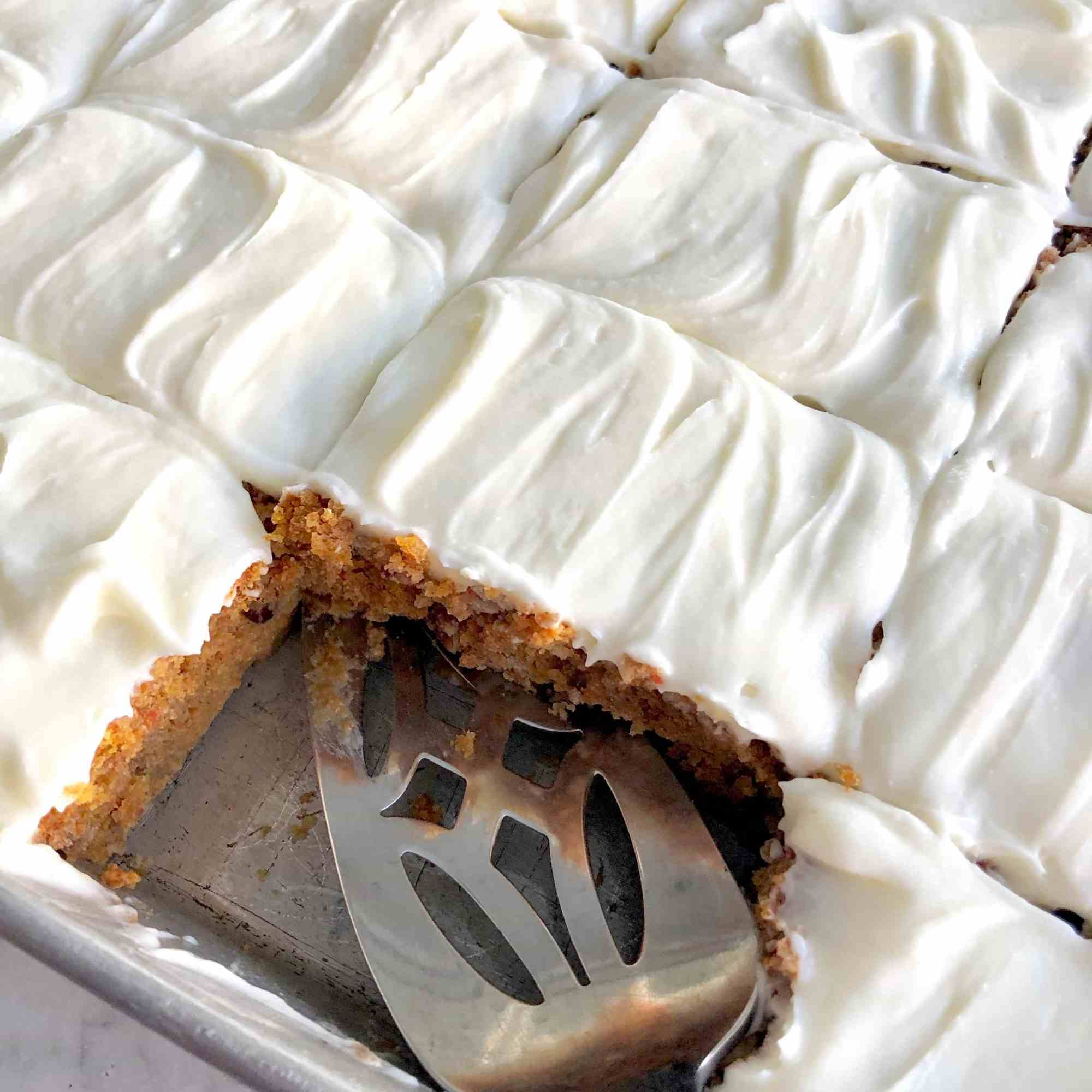 pumpkin spice flip cake with icing in a sheet cake pan