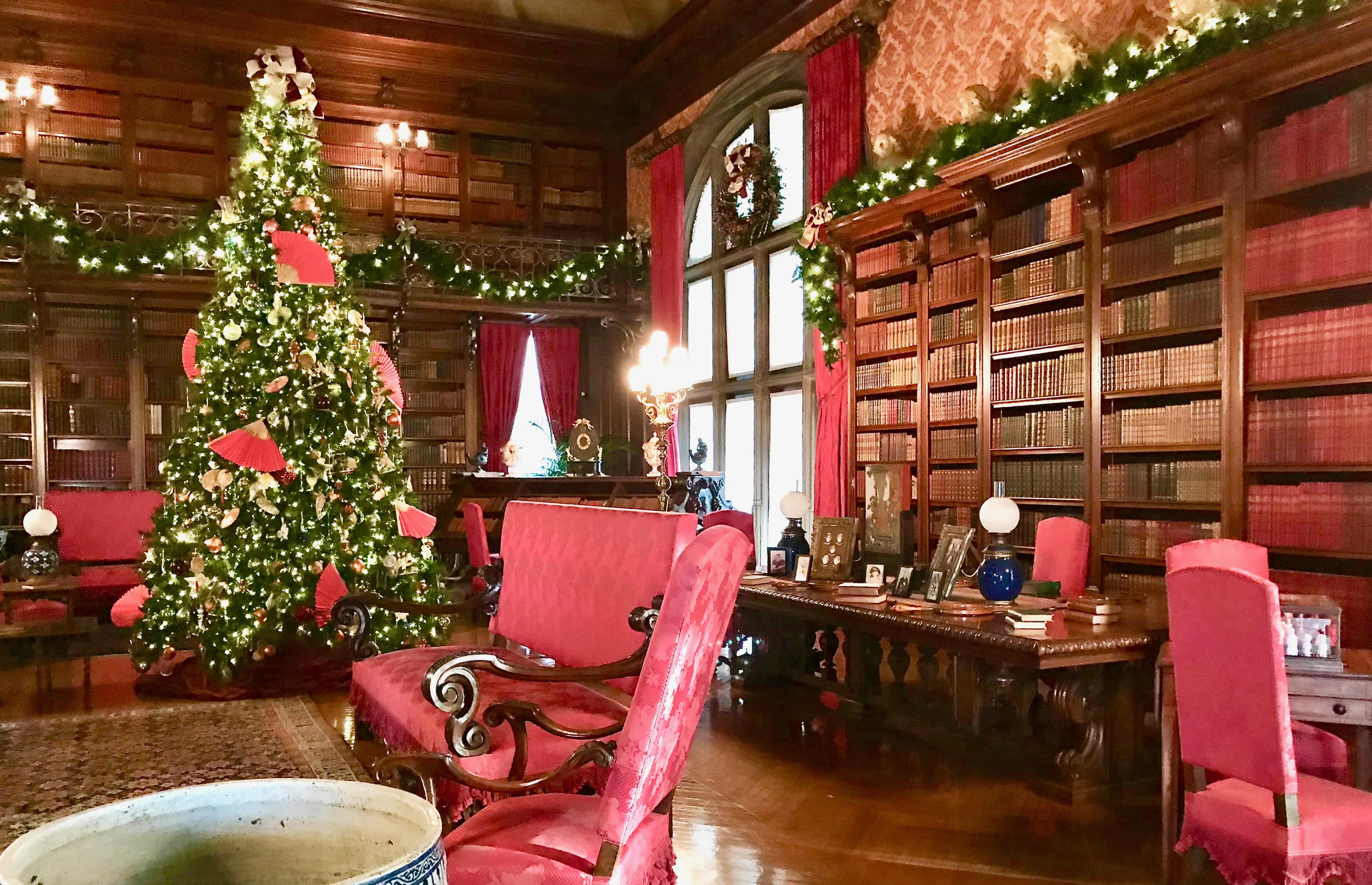 library with christmas tree at biltmore house