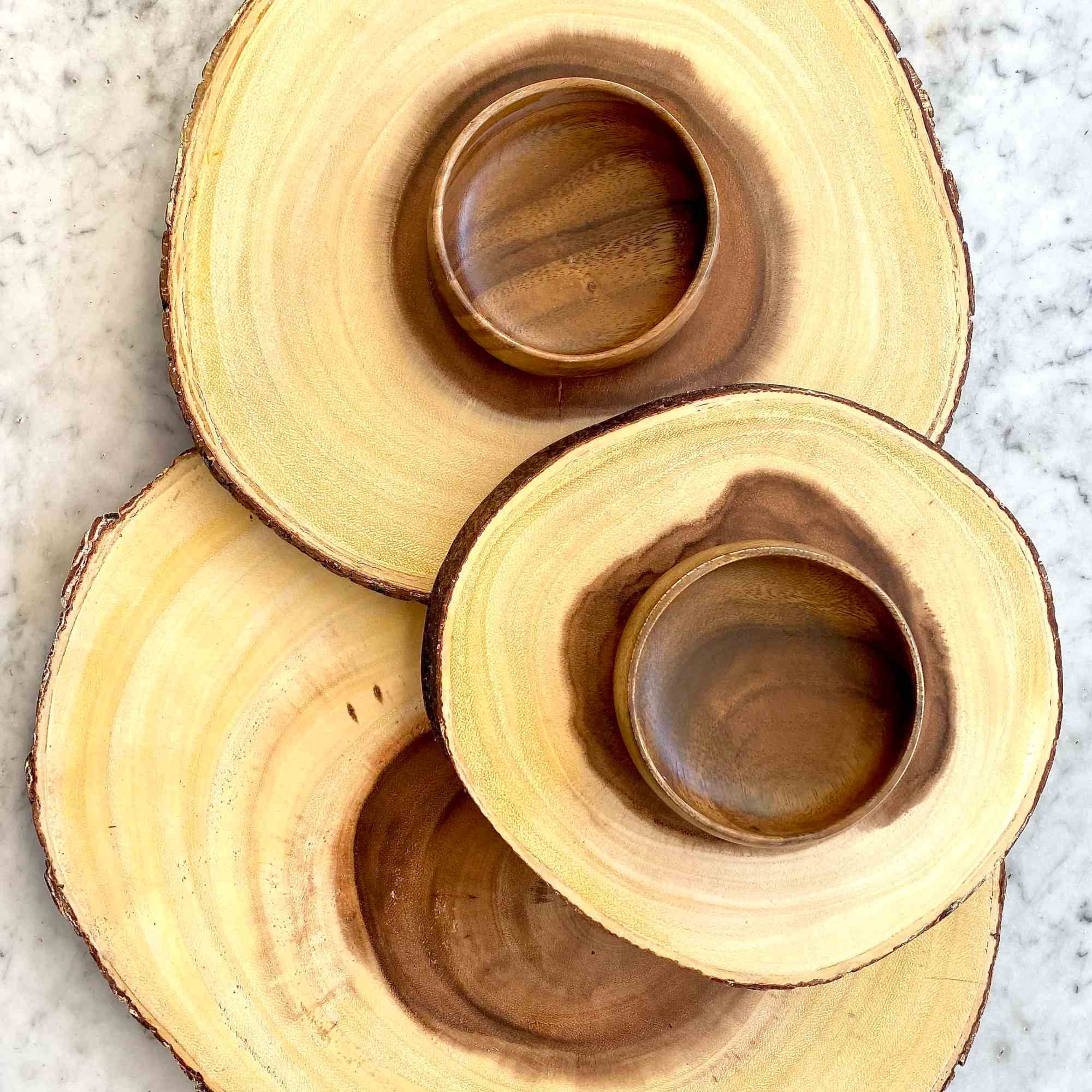 wooden circular cheese board made out of sliced wood