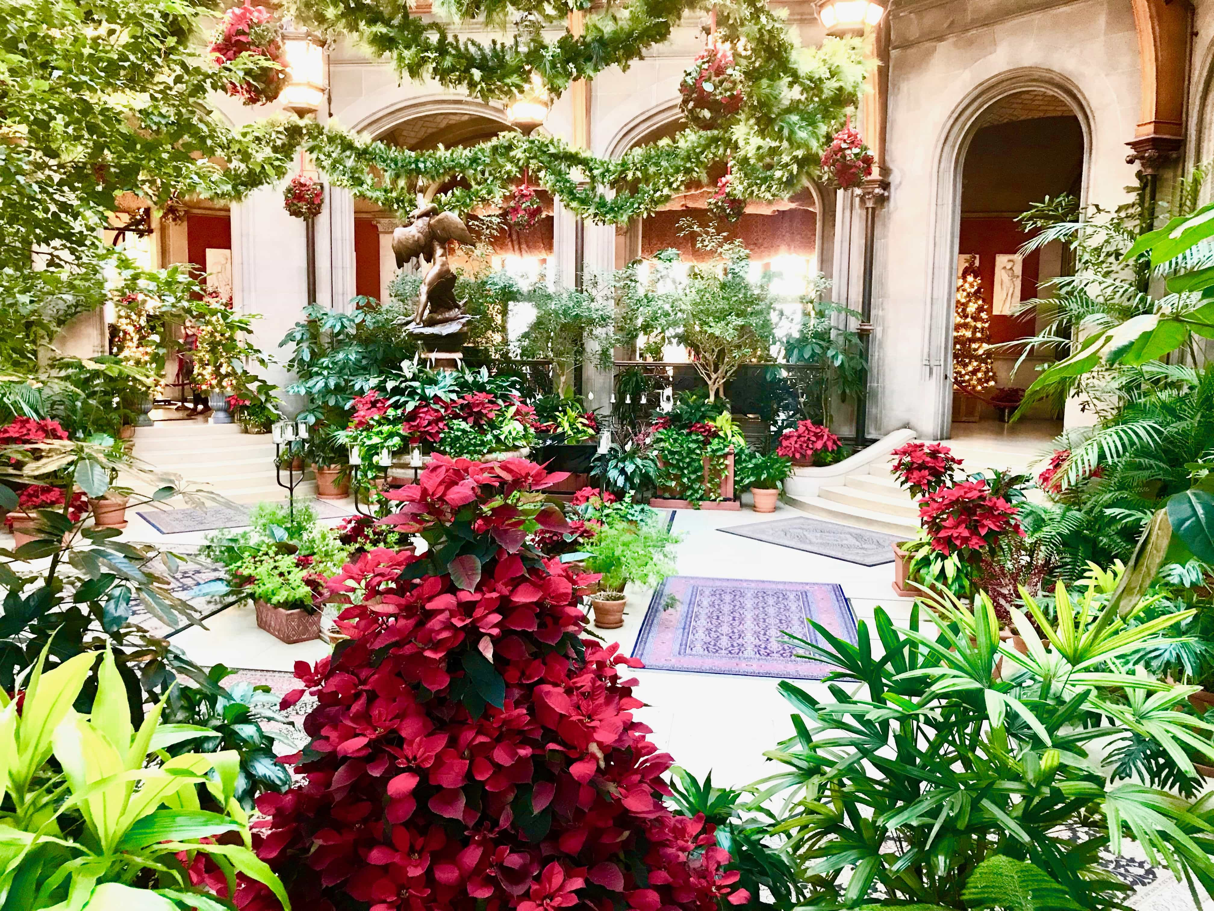 biltmore house atrium decorated for christmas