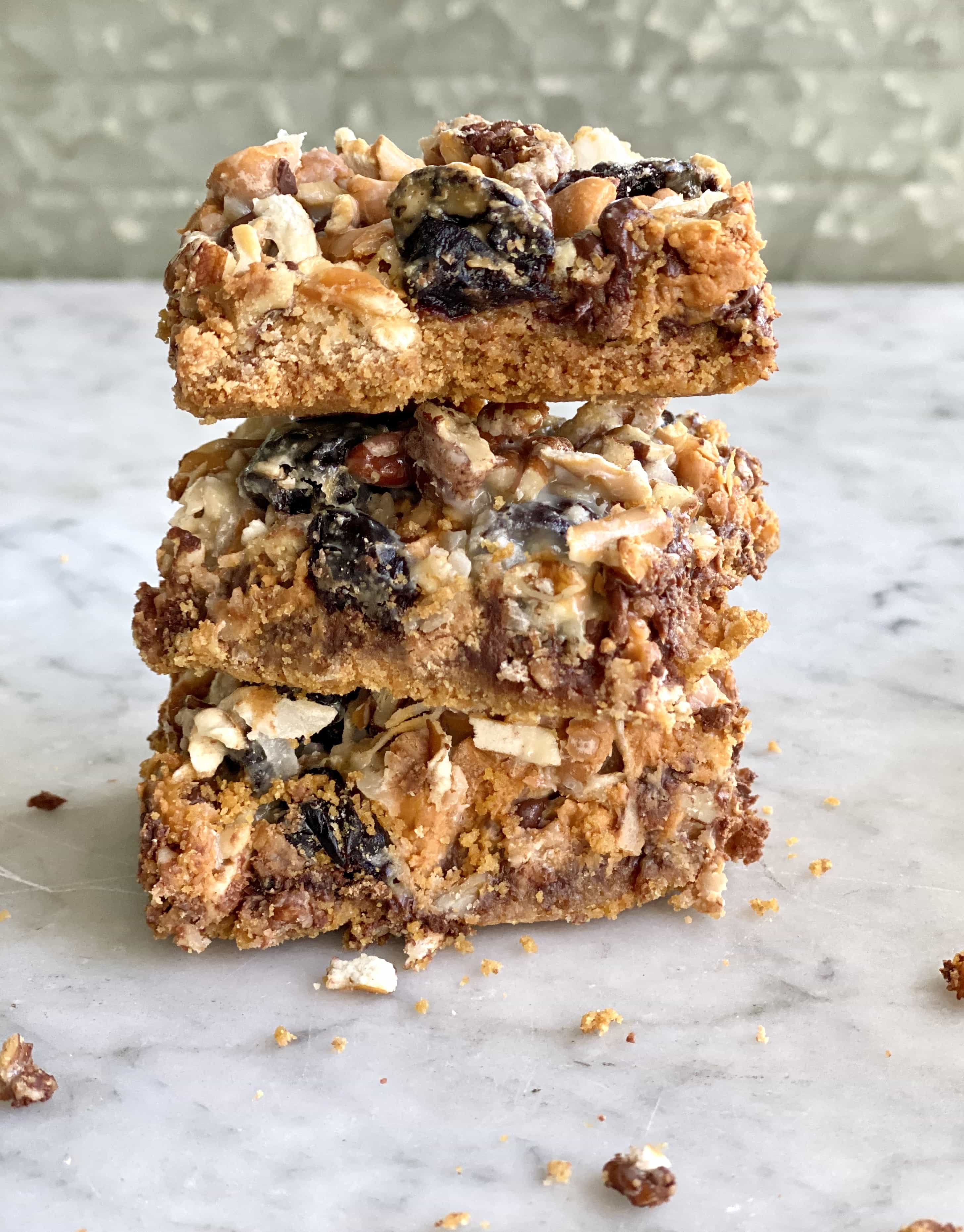 Cherry Magic Bars stacked on a marble table
