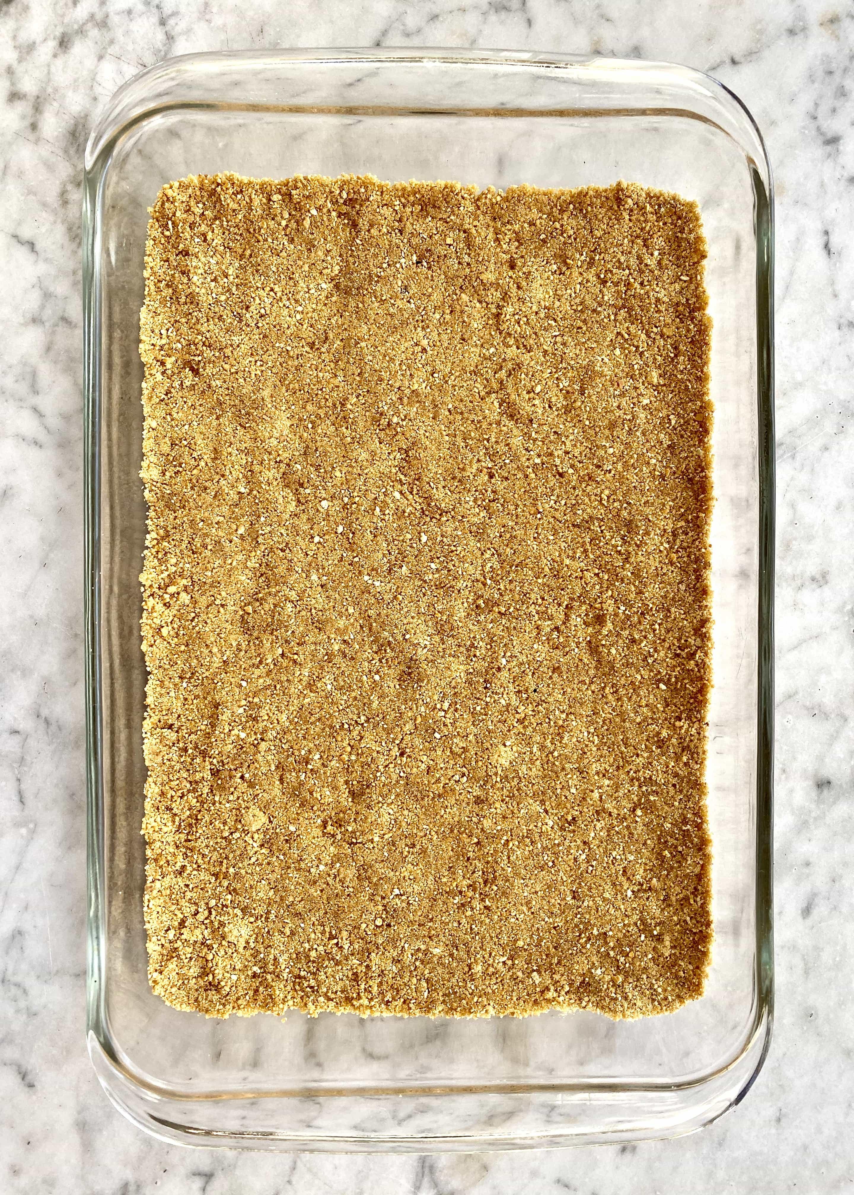 graham cracker crust in a 13 x 9 inch glass dish