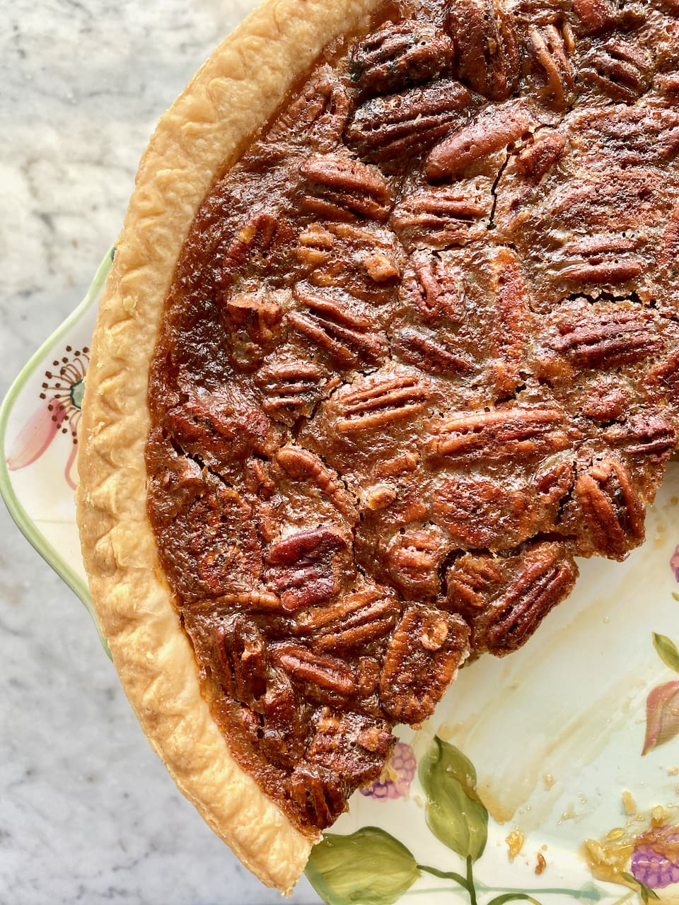 pecan pie on a floral plate