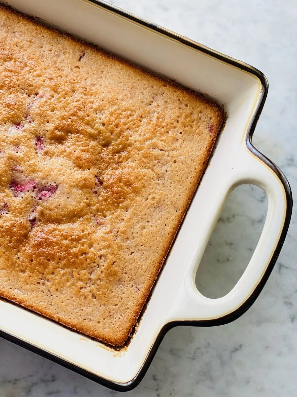 strawberry cake baked in a 13 x 9 inch pan