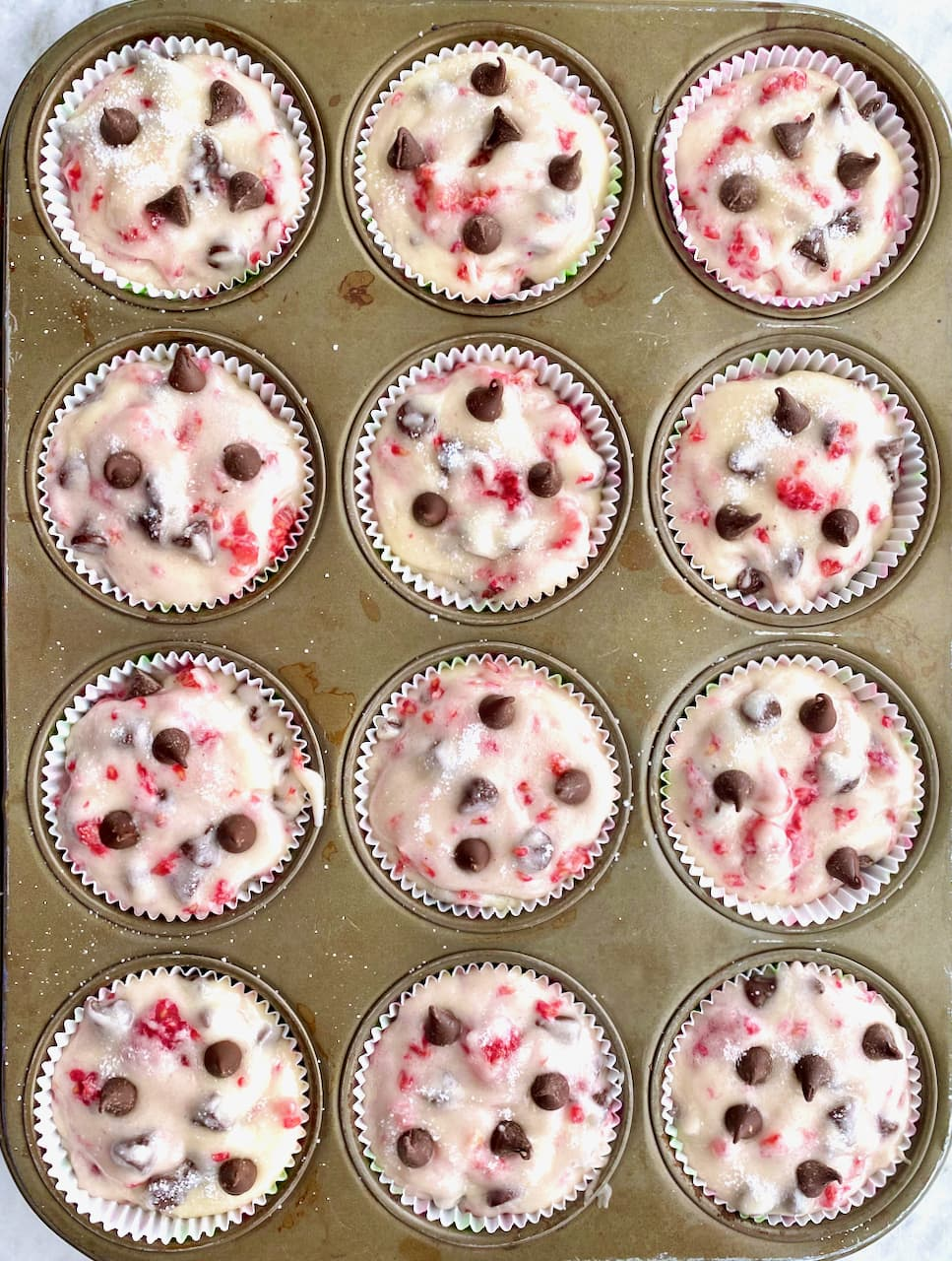 muffin tin pan filled with batter ready to go in the oven
