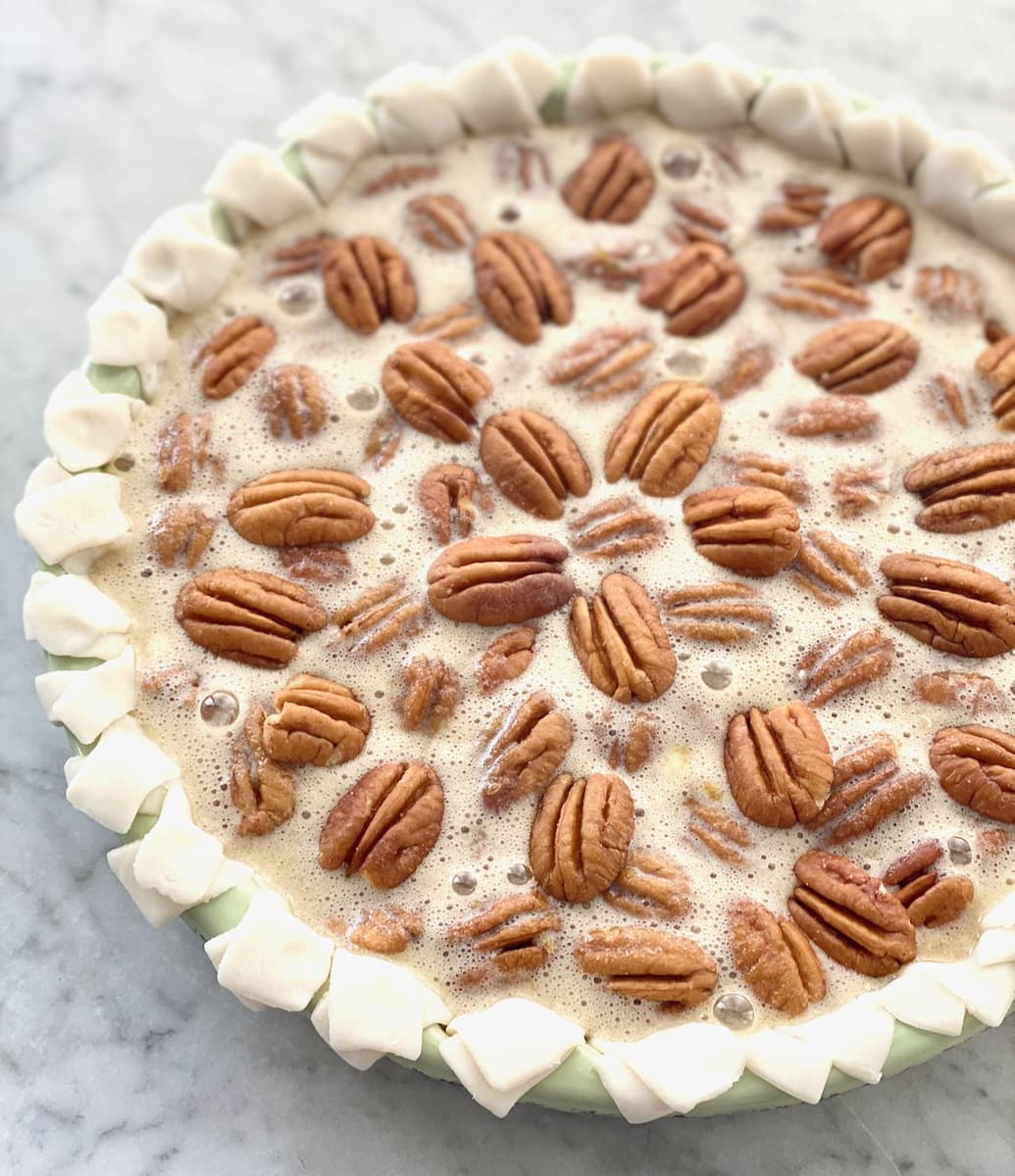 pecan pie decorated before going into the oven.