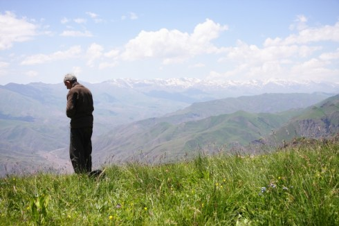 Praying senior in mountains