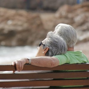 image of gray couple on bench