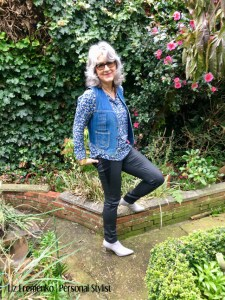 Image of Liz in blue print denim vest and skinny pants
