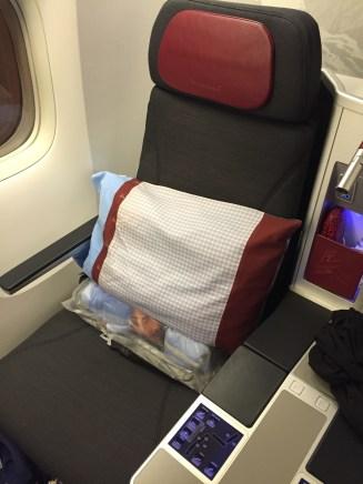 Cushy seat and a big pillow!