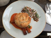 Pot pie over carrot puree