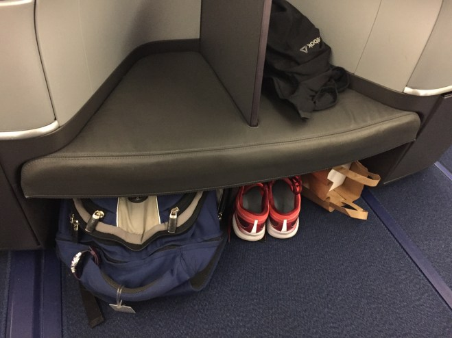 Storage below--usually not found in Business class!