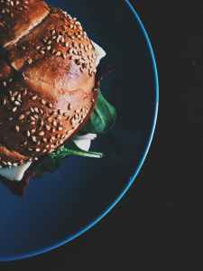 burger on blue ceramic plate