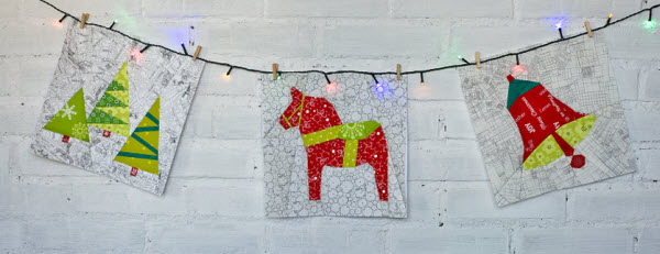 Christmas Sampler blocks on string of lights