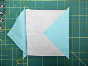 Square in a Square Tutorial - Second Triangle Sews Across from First