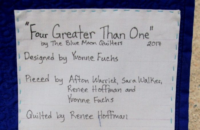 Four Greater Than One - Quilt Label