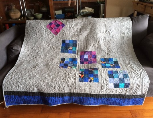 Quilt back over couch