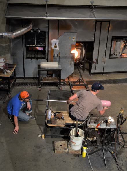 The auditorium nd the hot shop where you can watch the glass artists at work. The red chalk cartoon on the floor is a drawing of one of the pieces that were being created.