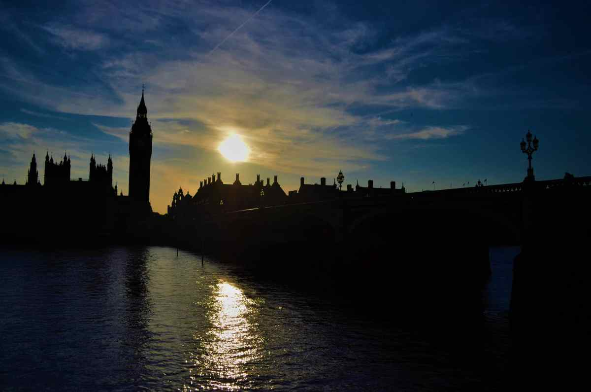 On my one day in London, the sun sets over Big Ben and the houses of Parliament in London