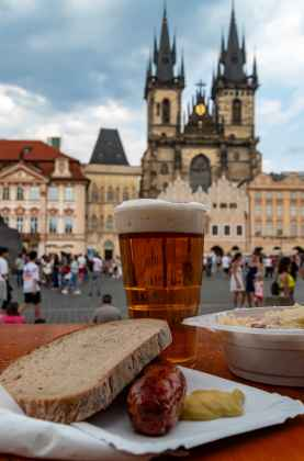 Enjoying a snack in the central square of Prague's Old Town