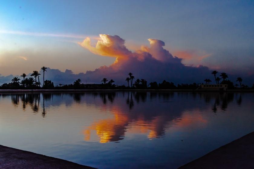 Sunset over the Menara Gardens reflecting pool