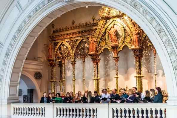 Chorus singing carols at the V&A