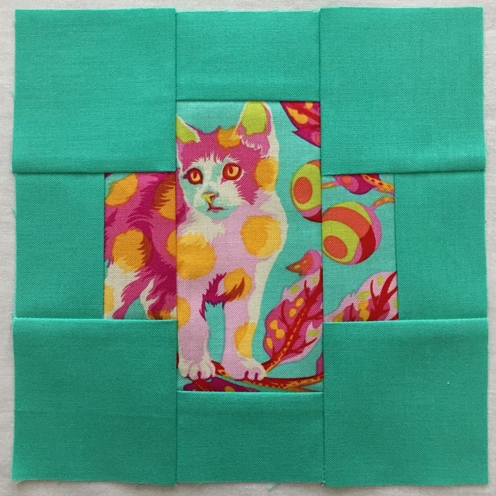 quilt block in mint green with a fussy-cut cat