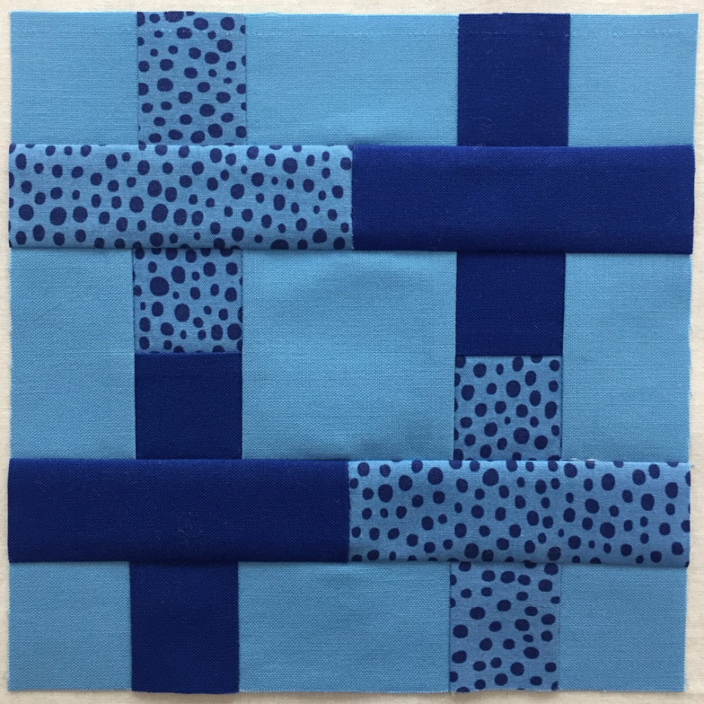 quilt block in blue with four plus-signs