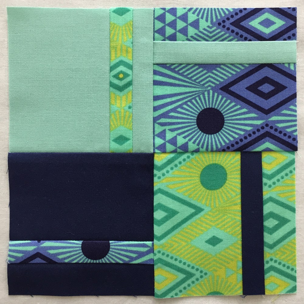 quilt block in green, turquoise, and blue