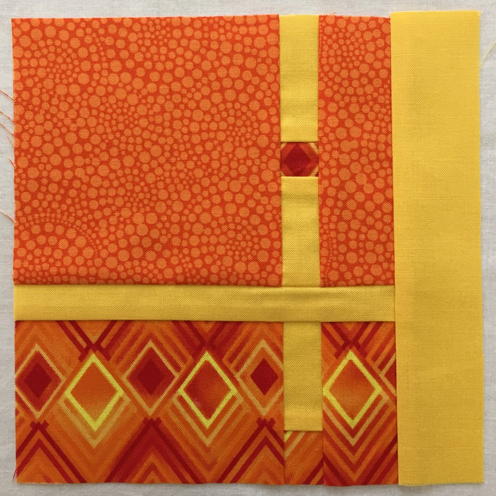 quilt block in yellow-orange