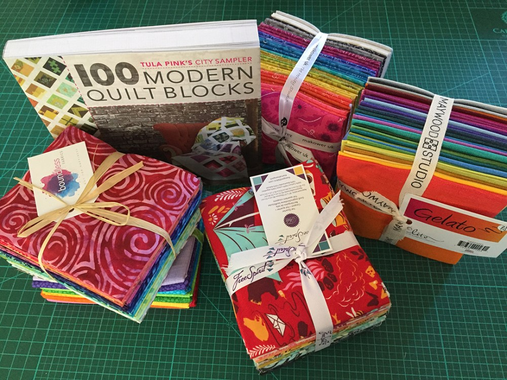 Different fabric bundles and the City Sampler book