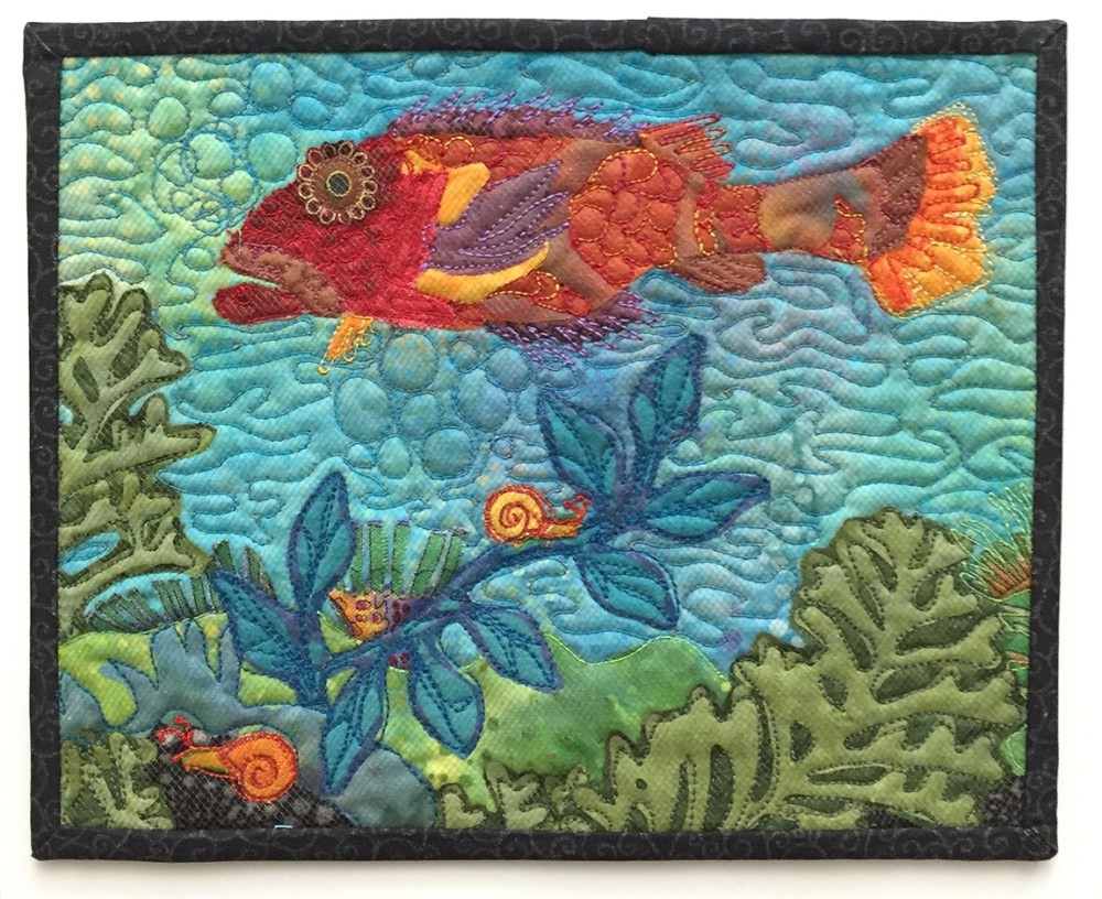 small quilt showing a fish and some undersea plants