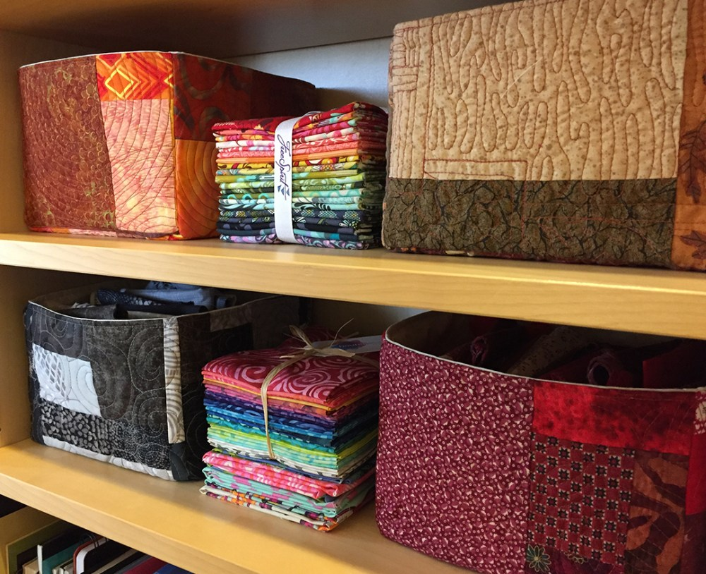 four fabric baskets in different colors