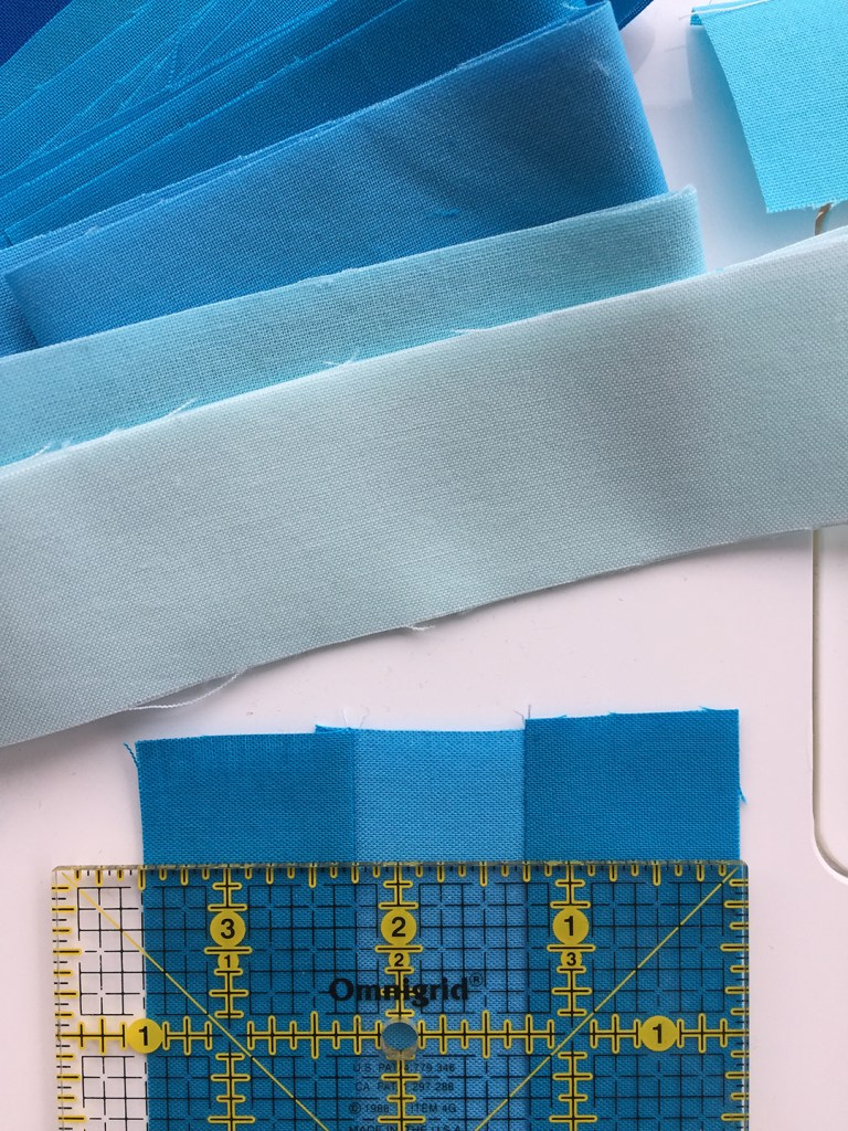 a ruler on top of a sample quilt block
