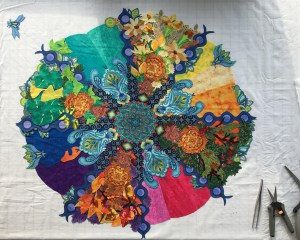 four rays of the mandala filled with seasonal foliage (fabric collage)