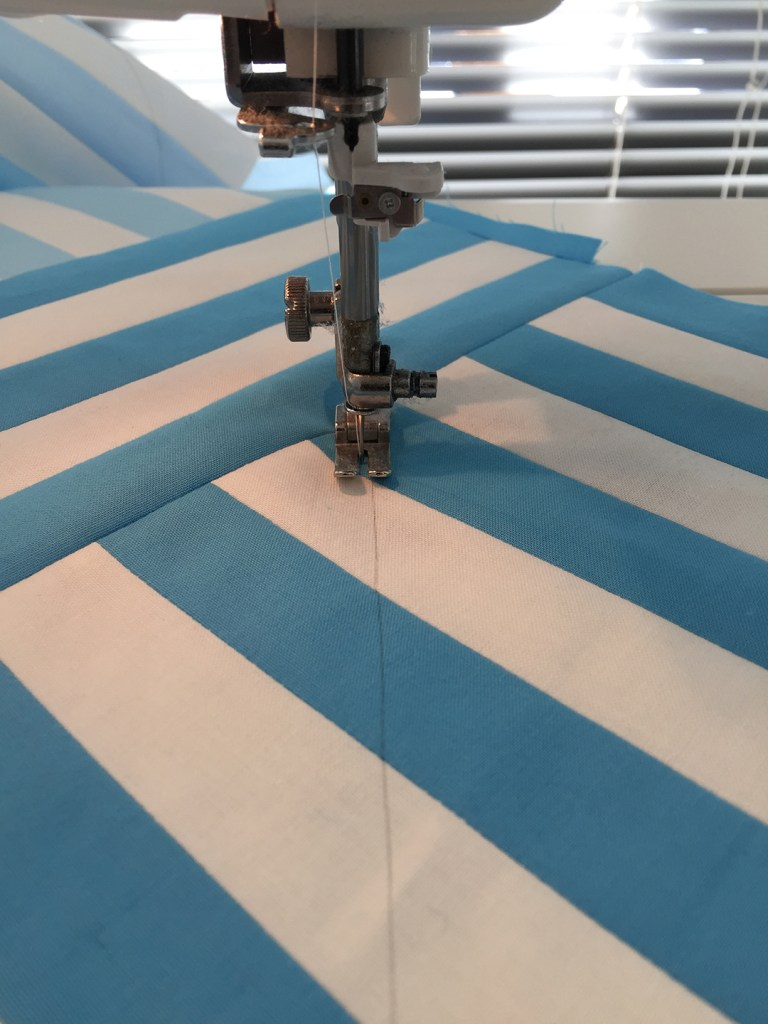 a quilt top loaded in a sewing machine