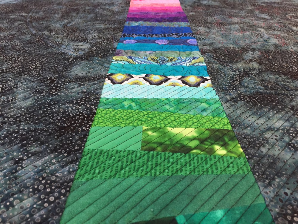 close lines of quilting on the back of the quilt