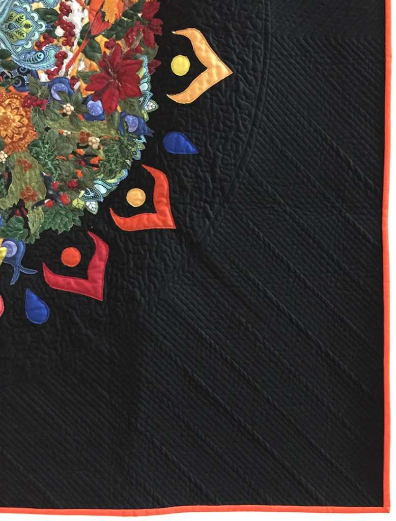 corner of a quilt showing quilting and binding