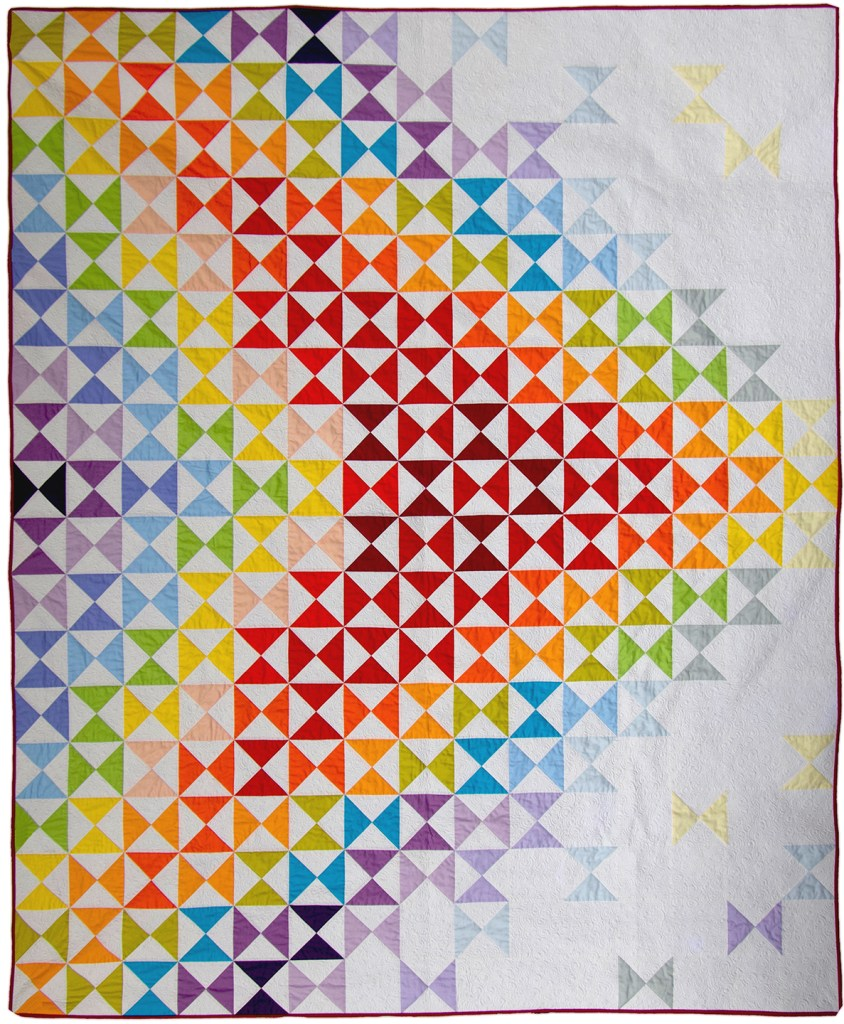front of rainbow and white quilt