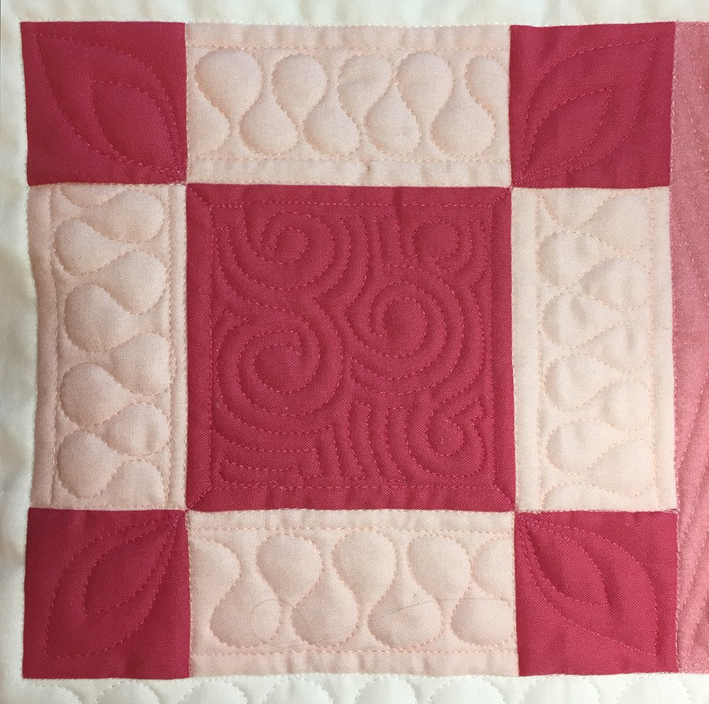 a quilted block in pink