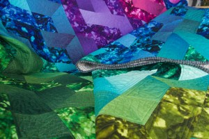 a colorful quilt draped and folded over on itself