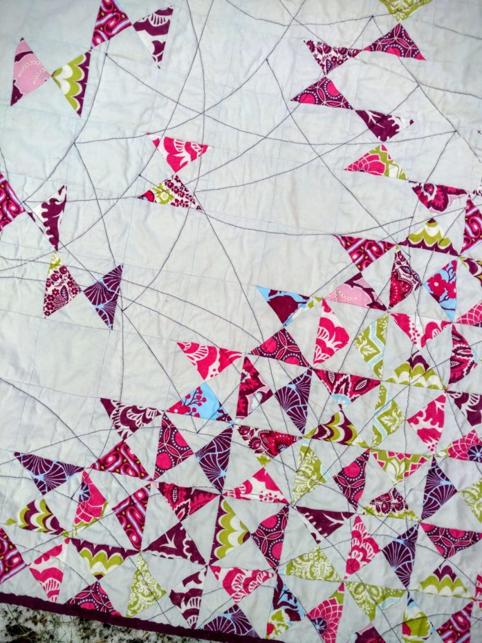 dancing quarter squares triangle quilt