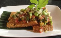 crispy fried tempeh with tomato, onion, avocado and broad beans