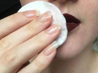 swiping off the lipstick